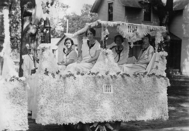 "Brodhead telephone operators ride on a parade float in 1925. The photo caption simply says ""Maude"" which indicates Mrs. Maude Bowen is one of the ladies. BELOW: Mrs. Lulu Mattison at left, looking over four telephone operators in this undated photo from Truman Olin."